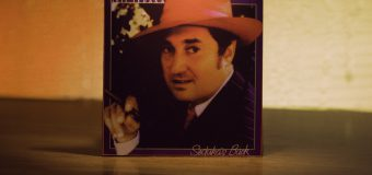 "Sedaka's Back by Neil Sedaka album art for the 1974 album featuring ""Laughter in the Rain"". Neil Sedaka in a red fedora with a cigar in his hand."