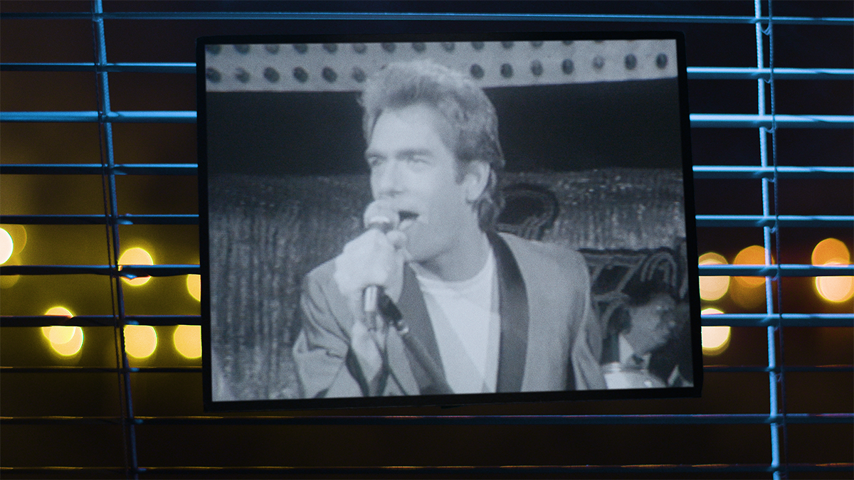 "Huey Lewis singing ""The Heart of Rock and Roll"""